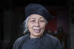Banzhao 703 (PEOPLEIMEET) Tags: china street old travel grandma ladies people woman house home hat lady race portraits photography one village sad shanghai faces time grandmother retrato no tiger traditional border chinese beijing streetphotography vietnam tay farmer zodiac  tradition granny stories ethnic minority region wrinkles ritratto cina humans portre  indigenous nanning zhuang portrat gabor guangxi  streetportraits minorities  onerace  potret noborders hony   peopleimeet peopleinchina oldfaces  banzhao humansofnewyork humansof humansofchina humansofshanghai humansofbeijing zhuanglong