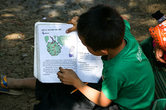 Studying under the tree, Hmong village near Luang Prabang, Laos (inchiki tour) Tags: travel boy people photo asia southeastasia village laos ethnic luangprabang hmong  louangphrabang