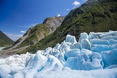 Blue ice of Fox Glacier in South Island of New Zealand (Dmitri Naumov) Tags: blue newzealand sunlight mountain ice nature beauty landscape outdoors nationalpark rainforest melting day landmark glacier crack nz foxglacier southisland geology icy fracture westcoast westland climate touristattraction scenics snout glacial eroded temperate traveldestinations extremeterrain tropicalclimate