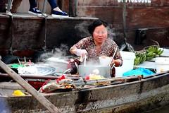 Floating market - Part 3: Fresh food (dananguyen) Tags: food boats asia southeastasia market floating fresh vietnam 75300mm floatingmarket steaming cantho southernvietnam canont3i