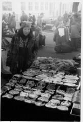 Mask seller (Art-WooD.de) Tags: life street leica city people face analog darkroom cat print pattern mask market streetphotography repetition nocrop pure fleamarket elmar seller iiia nocropping focomat v35 5cm