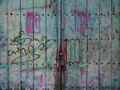 streets of cartagena (maximorgana) Tags: door wood pink green abandoned lamp rusty pg derelict cartagena latch aldaba trashbit