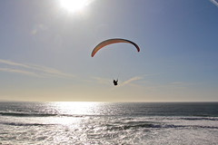 Out to Sea (KC Mike D.) Tags: ocean sunset sky man clouds waves sailing pacific horizon paragliding gliding
