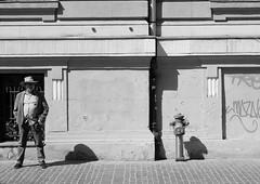 Man and Hydrant (PM Kelly) Tags: street blackandwhite bw man hydrant fire stand blackwhite story bnw brasov