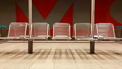 And I'm waiting for the train (raumoberbayern) Tags: red rot munich bank seats ubahn wait warten robbbilder urbanfragments