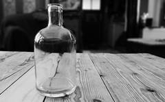 bottle & table (*Nils aus Kiel*) Tags: blackandwhite bw abstract table bottle glas lessismore