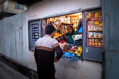Sidewalk cafe (longkati) Tags: street sunset woman man bread store labor tajikistan dushanbe non selling