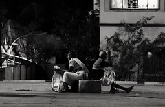 Strangers (Chiradeep.) Tags: blackandwhite monochrome night lowlight oldman oldwoman streetphotogrpahy