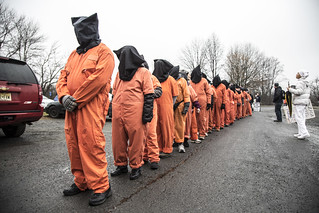 Guantánamo Detainees Line Up to March to the CIA