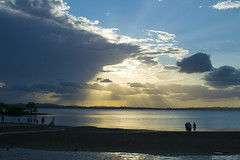 Sun Coming Through the Clouds (jadyn2014) Tags: sunset reflection clouds bay waterfront stormfront wellingtonpoint