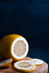 lemon slices on a dark background (lyule4ik) Tags: life wood flowers winter food brown white color macro green yellow horizontal fruit vintage dark table dessert wooden juicy still lemon healthy colorful raw view bright drink cut juice antique vibrant teal background rustic group cook fresh lemonade countries slice crop vegetarian citrus organic isolated wedge vitamins ripe ingredient brightly