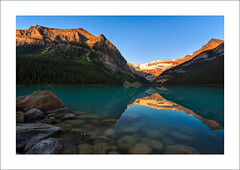Lake Of Glass (clark_monson) Tags: sunrise canoe alberta lakelouise banffnationalpark canadianrockies mountvictoria victoriaglacier fairviewmountain