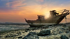 Abandoned boat (khalid almasoud) Tags: leica landscape bay boat wooden flickr 5 estrellas kuwait dlux doha