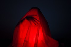 Amidst the red glow (Rand0mmehere) Tags: red black silhouette blackbackground dark scary glow hand veil darkness linnea fantasy mysterious cloak amidst albrechtsson rand0mmehere