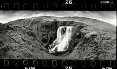 Appear to Dissapear (tsiklonaut) Tags: horizon 202 panorama panoramic pano 135 35mm film analog analogue analogica analoog roll agfa apx 400 ethol ufg island fagrifoss foss kosk landscape f206 black white negro y blanco mustvalge bw monochrome drum scan drumscan scanner pmt photomultipliertube wide grayscale travel discover experience maastik sky dramatic erosion valley org fagri ngc texture erosioon jõgi iceland