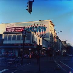 Europaweit breit... (Helldorado Berlin) Tags: blue sky signs berlin schneberg advertising trafficlight billboard departmentstore woolworth ubahn u1 saturdaymorning eurowings kurfrstenstrase hipstamatic blankofreedom13film foxylens oggl copywriterfail