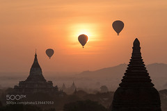 Balloons over Bagan, Myanmar (Pity411) Tags: travel sky people mountain hot color building nature weather silhouette horizontal fog architecture sunrise outdoors temple photography dawn pagoda flying image no air transport balloon buddhism nopeople structure transportation hotairballoon myanmar midair mode built bagan destinations traveldestinations colorimage modeoftransport 500px templebuilding builtstructure sunrisedawn ifttt