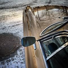 Winter Jewel (David Abresparr) Tags: car mirror volvo classiccar sweden stockholm bil p1800es p1800 rearmirror kungstrdgrden veteranbil brunnslock spegel spegling backspegel reflexer motorhuv swedishcar volvoshowroom volvocars