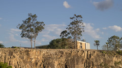 Living on the Edge (ZeroOne) Tags: city trees sky cliff house tree nature rock stone brisbane cliffs kangaroopoint kangaroopointcliffs epl3
