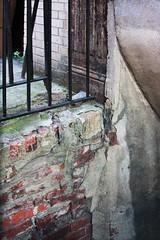 Crusty Bricks (lefeber) Tags: wood city nyc newyorkcity urban newyork wall architecture fence concrete downtown bricks entrance brickwall worn weathered railing peelingpaint
