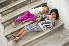 Resting (bag_lady) Tags: playing wooden burma steps monastery myanmar inlelake teak shweyaunghwekyaungmonastery