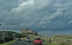 Castle and sky (Eddie Crutchley) Tags: england sky castle clouds outside europe northumberland bamburgh historicbuilding bamburghcastle
