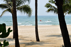 Disturbing the peace (Roving I) Tags: ocean sea tourism lifestyle vietnam palmtrees beaches leisure watersports whitesand danang activities jetskis