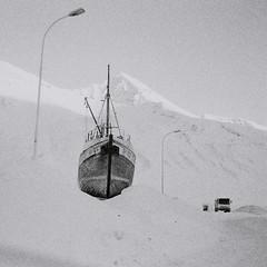 chou (asketoner) Tags: road city winter mountain snow truck daylight boat iceland construction ship harbour citylights wreck peninsula siglufjordur trollaskagi