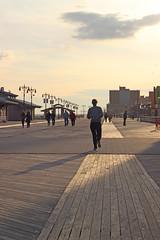 On the boardwalk (Milou Diable) Tags: sunset shadow newyork beach silhouette brooklyn coneyisland seaside twilight sand shadows fairground dusk silhouettes boardwalk