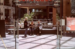 Potential customers? (Nodding Pig) Tags: uk greatbritain england film shop 35mm bristol entrance shoppingcentre scan doorway transparency shoppers 2015 agfachrome ct100 pentaxsp1000 takumar55mm cabotcircus 20150705a012101