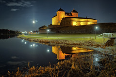 Castle at moonlit night (Digikuvaaja) Tags: old travel bridge blue red moon lake reflection building brick tower castle history tourism monument water wall architecture night finland dark stars landscape evening still ancient europe european cityscape exterior fort outdoor dusk stones perspective landmark scene medieval historic mysterious historical moonlight fortress defense touristic moonshine hmeenlinna