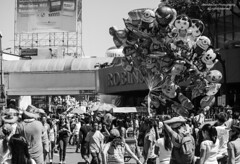 Festival and Balloons (Don Pablo Tan) Tags: street party summer people blackandwhite bw monochrome festival balloons toy crowd streetphotography heat crowded