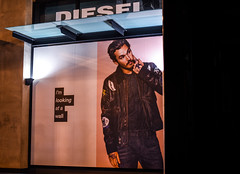 i'm looking at an idiot (pbo31) Tags: sanfrancisco california winter orange black color male window wall night dark idiot model nikon diesel ad january bayarea marketstreet unionsquare 2016 boury pbo31 d810