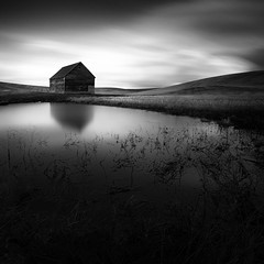 Moment in Time (Grant Meyer Photography) Tags: county bw water monochrome field grass barn rural landscape photography blackwhite pond long exposure northwest wheat idaho backroads latah 10stop thepalouse upperleftusa sonya6000 rokinon12mmf2