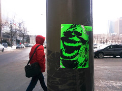 Slimer (Indrid__Cold) Tags: street winter streetart cinema color green art film monster movie stencil montréal drawing montreal hiver ghost vert dessin pole lamppost poteau slime rue stencilart lightpole passerby ghostbusters greenmonster cinéma slimer ectoplasm monstre ghostbuster onionhead ectoplasme monstrevert littlespud sedgewickhotel