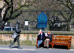 Figures (john atte kiln) Tags: uk statue wall bronze bench walking scotland edinburgh manwoman sitting unitedkingdom britain pavement bald poet churchyard parkbench homage figures 18thcentury youngman kirk contemplating canongate robertfergusson striding womanman churchnotice