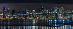 save the endangered colorful san franciscan (pbo31) Tags: sanfrancisco california city bridge winter urban panorama motion black color reflection green northerncalifornia skyline night dark oakland nikon over january large panoramic baybridge bayarea eastbay lowtide 80 stitched alamedacounty portofoakland 2016 lightstream boury pbo31 d810