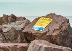 MIND HOW YOU GO (mrstaff) Tags: lighthouse art beach danger rocks surf waves bright debris norfolk dry windy sunny cliffs groyne happisburgh coastalerosion seadefense martinstafford january282016