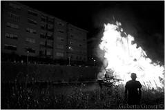 (Gilberto Grossi) Tags: street shadow blackandwhite man night river fire folk fiume ombra uomo burning blaze notte fuoco biancoenero