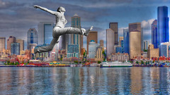 Leaping in Seattle (swong95765) Tags: seattle city woman water jump waterfront leap