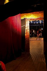 (lewispedervel) Tags: red people yellow vintage lights dancers dancing circus entrance warmth tent indoors faded inside
