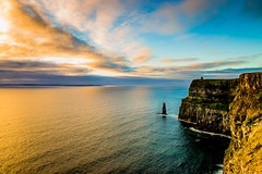 Cliffs of Moher at sunset (Kuba Abramowicz) Tags: county ireland sunset cliff cloud sun color colour colors yellow clouds composition landscape outside outdoors gold golden nikon colorful europa europe clare european colours cloudy outdoor horizon eu sunny landmark cliffs hour 24mm f80 nikkor moher goldenhour d610 2470