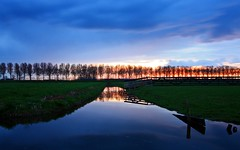 April sunset (M a u r i c e) Tags: trees sunset sky color colour nature water netherlands grass fence reflections landscape pond horizon grassland efs1022mm