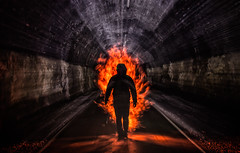 Urban Shakedown.  105-366. (FadeToBlackLP) Tags: world uk longexposure orange lightpainting man abandoned silhouette night canon dark underground fire movement glow darkness time zoom taken wideangle tunnel tokina trail figure 105 tor chee urbex railwaytunnel monsaltrail monsal 366 zoompull 1116mm cheetortunnel