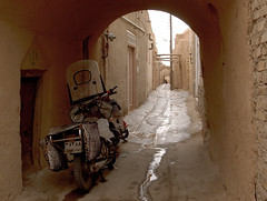 Motorcycle by the doorstep in narrow Yazd alley, Iran (Germn Vogel) Tags: travel tourism alley arch iran empty middleeast tunnel motorbike alleyway motorcycle lone silkroad lonely doorstep yazd oldquarter islamicrepublic westasia gettyimagesmiddleeast