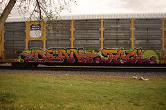 DEAN JACL (TheGraffitiHunters) Tags: auto street pink red orange white black green art car yellow train graffiti big colorful paint dean tracks spray rack covered carrier freight autorack jacl benched benching