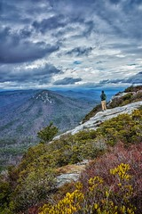 High up on Table Rock looking over to Hawksbill Mtn in the Linville Gorge last month. You can see from my pant leg how strong the wind was on this morning. It was so strong it nearly blew my camera and tripod over right after this shot was taken (plottsdaniel) Tags: longexposure trees sky mountains nature beautiful clouds landscape landscapes nc nikon pretty view asheville hiking hike nikkor dslr boone appalachia blueridgemountains linvillegorge blueridgeparkway blueridge selftimer appalachianmountains wnc linvillefalls landscapephotography prettyview ashevillenc mommanature