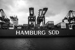 HAMBURG SUD (b. ellabarger) Tags: blackandwhite bw reflection water rain port river germany boat blackwhite europe gloomy cloudy ships hamburg overcast cargo rainy grainy bandw shipping loadingdocks hamburggermany elberiver hamburgsud loadingships blackandwhitedrama