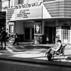 Santa Monica   |   Broadway Bookworm (JB_1984) Tags: california ca people blackandwhite bw usa cinema person mono unitedstates theatre santamonica broadway streetphotography socal squareformat southerncalifornia thirdstreetpromenade losangelescounty theatremarquee