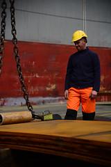 Loading steel sheet (larry_antwerp) Tags: sunshine port ship belgium belgi vessel antwerp  antwerpen longshoreman  dokwerker schip docker                            9393632